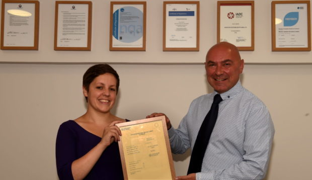 Councillor, Kirsty Blackman presents Brian Sinclair, Monitor Systems Scotland Limited, Aberdeen with their award.