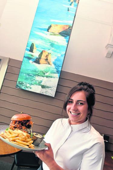 Supervisor Leanne Hampton with The Dirty Spaniard burger.