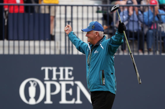 Sandy Lyle after holing his birdie putt on the 18th.
