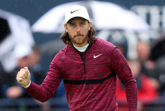 England's Tommy Fleetwood celebrates his birdie on the 18th during day two of The Open .