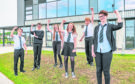 L-R - Angus Little, Stewart Ewen,, Emily Sutherland,, Eilidh Stewart, Andrew McIntyre and Morgan McRitchie at Elgin High School all jumping for joy at passing their exams.