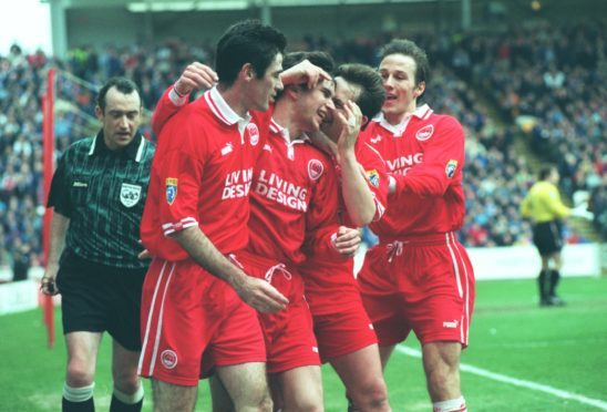 Stephen Glass is congratulated by Mike Newell, Billy Dodds and Eoin Jess after scoring against Rangers in 1998.