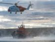 HM Coastguard helicopter and RNLI lifeboat