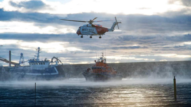 Coastguard and lifeboat teams were sent to Buckie Harbour. Picture: John Duncan.