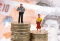 File photo dated 27/01/15 of plastic models of a man and woman standing on a pile of coins and bank notes, as around half of companies required to submit their gender pay gap figures to the Government have yet to do so, with a week until the deadline. PRESS ASSOCIATION Photo. Issue date: Wednesday March 28, 2018. By April 4 an estimated 9,000 companies and public bodies with 250 employees or more have to have submitted their median and mean gender pay gap data to the Government Equalities Office. See PA story INDUSTRY GenderPay. Photo credit should read: Joe Giddens/PA Wire