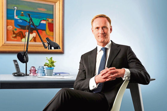 """Burness Paull chairman Peter Lawson is optimistic after the firm's profits rose again despite a """"choppy"""" economy."""