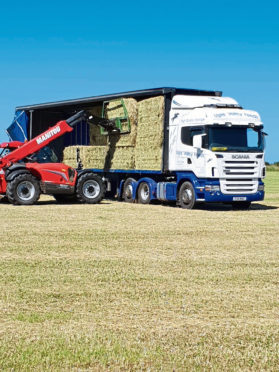 Bales being load on a lorry for Ugie Valley Feeds.
