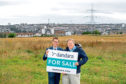 Peter Best, left sales director for Dandara, and Bruce Smith, for the Grandhome Trust, at  the Grandhome Whitestripes site.