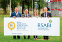 RHASS chief executive Alan Laidlaw, RHASS chairman Jimmy Warnock, Nina Clancy from the RSABI and RHASS honorary secretary  William Gill.