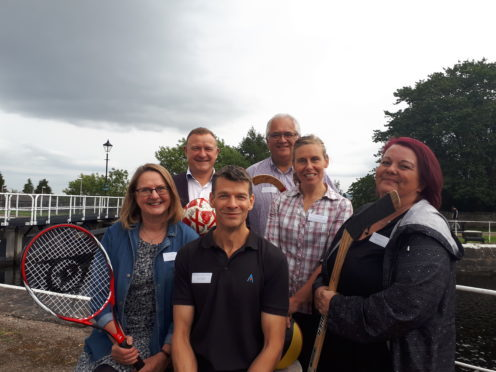 Drew Hendry MP, Keith Walker of Befrienders Highland, Jodi Sharpe of The 25th Hour, Gail Duff of Signpost, Malcolm MacSween of ActivNess and Viv Mackie of Serenity gather to celebrate the opening of ActivNess facility on Canal Road, Inverness.