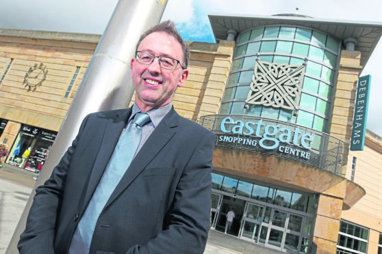 Stewart Nicol, Chief Executive of Inverness Chamber of Commerce, in Falcon Square outside the Eastgate Centre in Inverness town centre. Picture by Andrew Smith