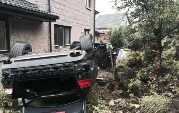 The scene of a crash where an Audi S5 crashed off the A90 southbound into the back of a house on St Ternans Road in Newtonhill.