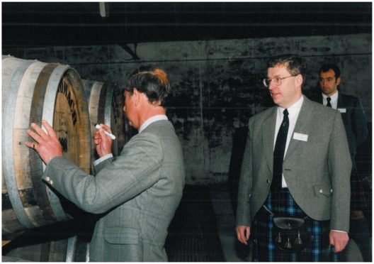Prince Charles signing the first cask of Benromach whisky at the reopened distillery in 1998
