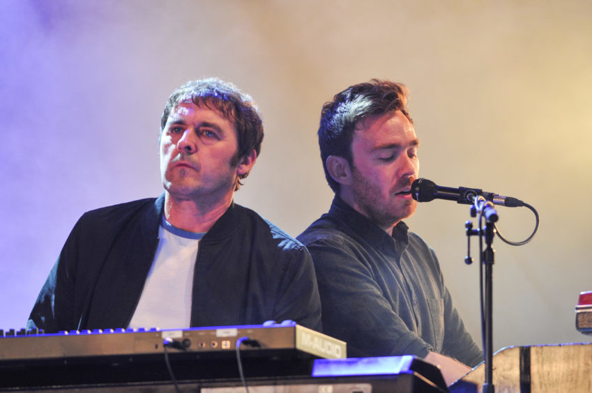 The Charlatans perform on the Garden Stage with members of Frightened Rabbit