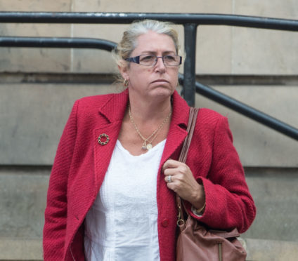 Michelle Harshaw leaves Elgin Sheriff Court.