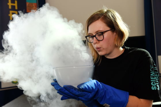 Picture of Akvile Terminaite experimenting with liquid nitrogen. Picture by Kenny Elrick.