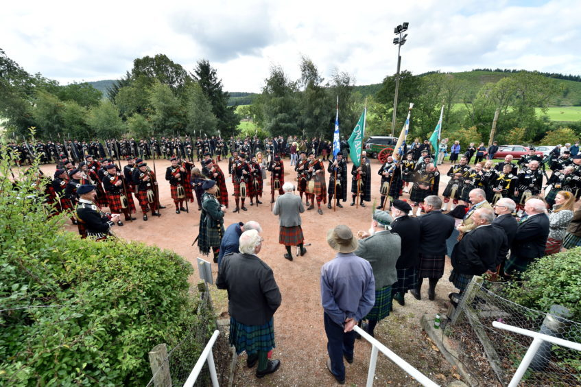 The Lonach Highlanders on their six-mile march.