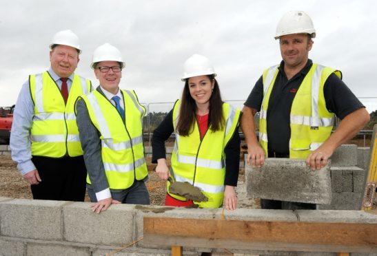 Scottish housing minister Kevin Stewart visited two projects by the Lochalsh and Skye Housing Association (LSHA) with LSHA's Lachie MacDonald, Kate Forbes MSP and a builder at the site. Picture by Sandy McCook.