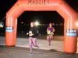 Runners and walkers cross the finishing line on the main runway. All pictures by Sandy McCook.