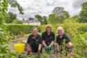 Beth Dunlop, Dorothy Allan and Ann Davidson sow seeds in Elgin's Cooper Park.
