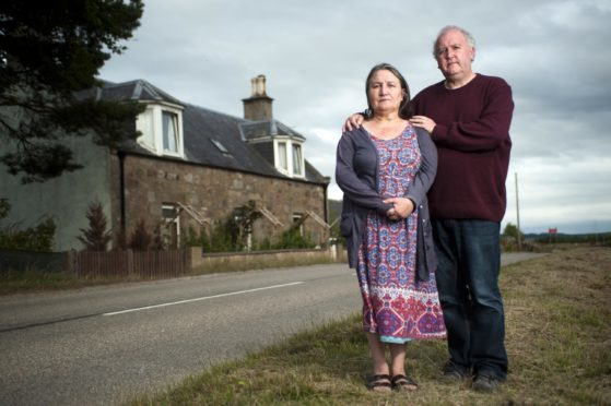 Gaynor and Tim Barry outside their home near Macallan's distillery.
