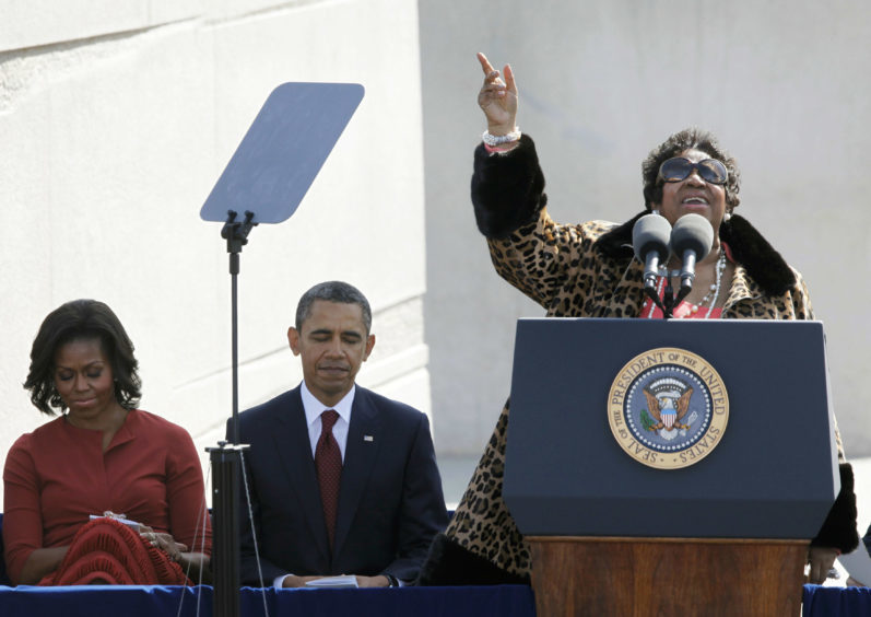 Aretha Franklin sings before President Barack Obama speaks during the dedication of the Martin Luther King Jr. Memorial in Washington. (AP Photo/Charles Dharapak)