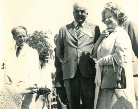 William Noss Clyne with the Queen Mother and shepherd Jimmy Gunn, right.