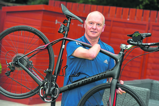 Doug McIntosh is undertaking a series of cycling events to raise money for his 4-year-old grandson.  Picture by Kenny Elrick.
