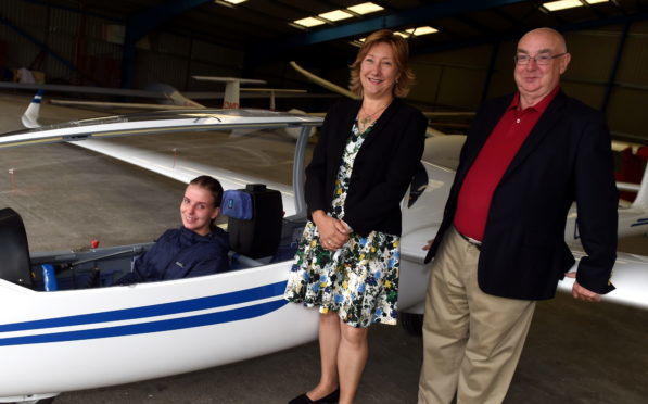 The Deeside Gliding club unveiled a new simulator at Aboyne. In the picture are from left: Maddy Draper, member, Claire Bruce, Visit Aberdeenshire and David Innes, committee member. (Picture by Jim Irvine)