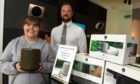 Aimi Forsyth receives her prize from Aberdeen Bang & Olufsen store manager Ryan Hughes.