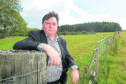 Councillor Ken Gowans in the Inshes area of Inverness where it is proposed to have over 500 timber lorry movements as Balvonie Wood is cut for timber.