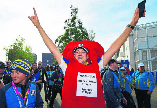 Ian Poulter of Europe celebrates winning The Ryder Cup after taking a Post Box outfit off of a fan during singles matches of the 2018 Ryder Cup at Le Golf National on September 30, 2018 in Paris, France.  (Photo by Stuart Franklin/Getty Images)