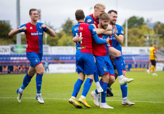 Inverness celebrate their second goal, scored by Shaun Rooney.