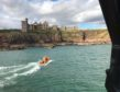 Peterhead RNLI on call at Slains Castle.