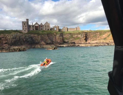 Peterhead RNLI on call at Slains Castle.
