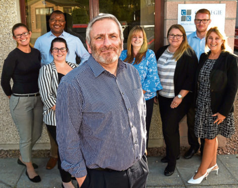 Small business profile: Alan MacPherson at Carnegie Knox, Blackburn. In the picture are from left: Lisa Frisken, Jane Annand, Kevin Okpewo, Alan MacPherson, Lesley Taylor, Iwona Beaton, Chris Durno and Lorraine Simpson.  Picture by Jim Irvine  5-9-18