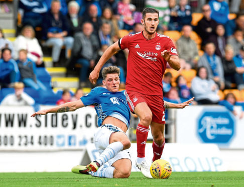 St Johnstone's Ross Callachan (L) in action against Aberdeen's Dominic Ball