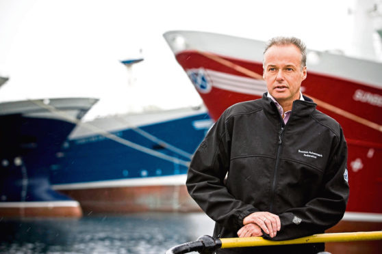 MEETING OF THE SKIPPERS OF SCOTLANDS PELAGIC FLEET IN FRASERBURGH.   PIC OF IAN GATT CHIEF EXECUTIVE OF THE SPFA, AT FRASERBURGH HARBOUR WITH PELAGIC FISHING BOATS.  PIC BY LEX BALLANTYNE / NEWSLINE SCOTLAND