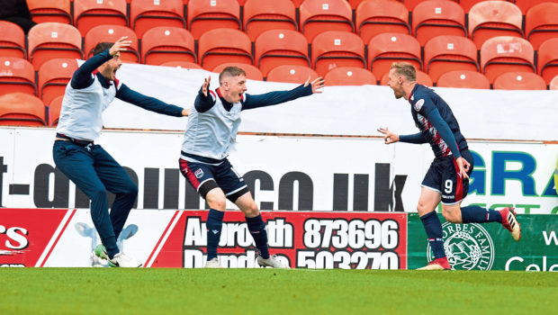 Ross County's Billy McKay (R) celebrates his third goal.