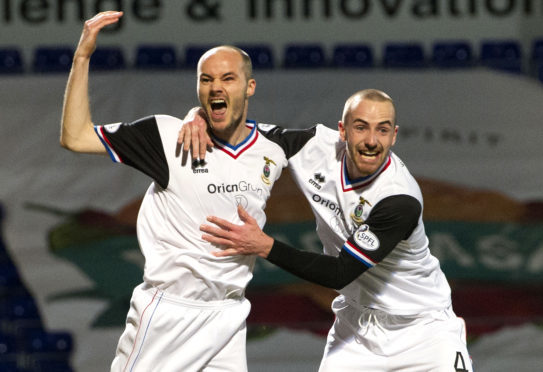 David Raven celebrates his goal with James Vincent in February 2014.