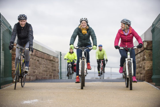 Cyclists cross the existing link on the Drumrosach Bridge which opened in 2016 linking the Inverness Campus and Inverness Retail Park.