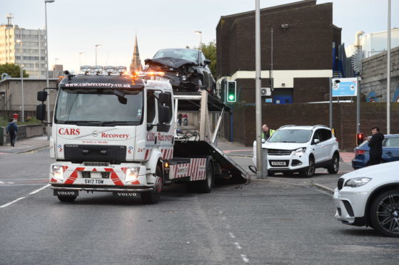 One of the vehicles being recovered following a five-vehicle pile-up on South College Street.