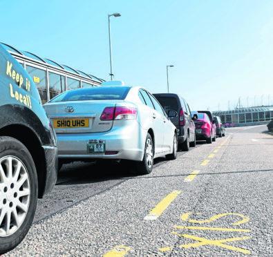 The taxi rank at Aberdeen International Airport.