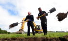 Aberdeen FC chairman Stewart Milne and Derek McInnes start work on the construction of the new Dons stadium at Kingsford