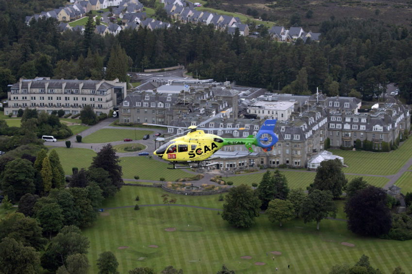 'Helimed 76' is pictured flying over Gleneagles Hotel