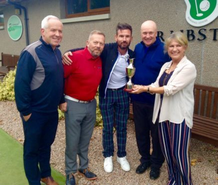 DREAM TEAM: Neale Cooper's sister, Shirley Blake, presents the trophy to winning team Tenaris Global Services, who are Graham Watson, Mike Halliday, Darren Chilton and Mike Ritchie.
