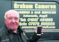 Graham Cameron with a mobile number on his van, but no reception where he lives.