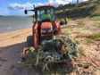 The tractor hauling marine litter from Sandford Bay last weekend