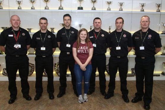 Laura Campbell with members of Scottish Fire and Rescue Service in Oban.