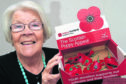 Beryl Watt looking for more help with selling poppies at Whitehills.
